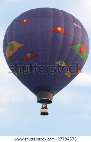 PUTRAJAYA, MALAYSIA-MAR 16: Michel Lambert (Belgium) with Air Of Quality balloon in flight at the 4th Putrajaya International Hot Air Balloon Fiesta Mar 16, 2012 in Putrajaya. - stock photo