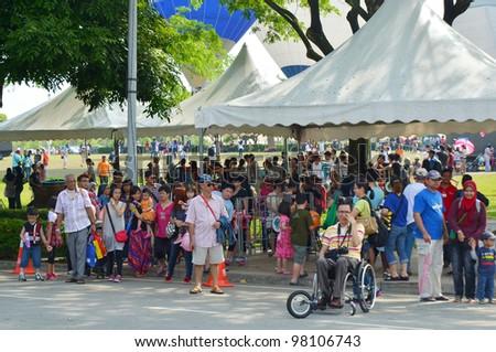 PUTRAJAYA, MALAYSIA-MAR 17:View of unidentified OKU and visitors in event at the 4th Putrajaya International Hot Air Balloon Fiesta on Mar 17, 2012 Putrajaya, Malaysia. - stock photo