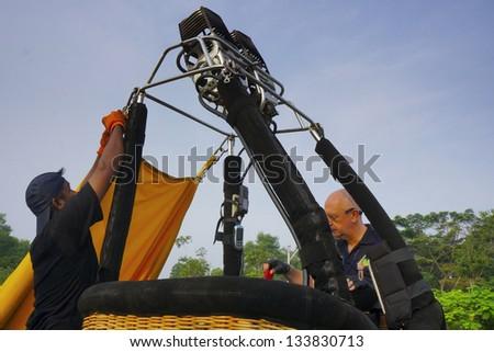 PUTRAJAYA,MALAYSIA - MARCH 31:Australian Crew set up the hot air balloon during 5th Putrajaya International Hot Air Balloon Fiesta 2013 on March 31,2013 in Putrajaya, Malaysia. - stock photo