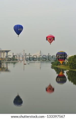 PUTRAJAYA, MALAYSIA - MARCH 30:Balloonists take part in morning flight during 5th Putrajaya International Hot Air Balloon Fiesta at Presint 2, Putrajaya on March 30, 2013. - stock photo