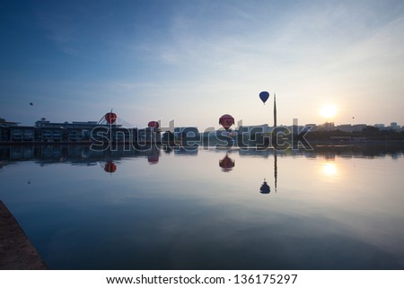 PUTRAJAYA, MALAYSIA - MARCH 30:Colourful hot air balloons floating over sunrise skies at the 5th Putrajaya International Hot Air Balloon Fiesta in Putrajaya, Malaysia on March 30, 2013 - stock photo