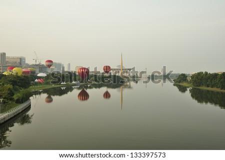 PUTRAJAYA, MALAYSIA - MARCH 30:Hot air balloons inflate as preparation for morning flight during 5th Putrajaya International Hot Air Balloon Fiesta at Presint 2, Putrajaya on March 30, 2013. - stock photo