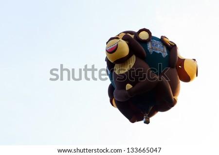 PUTRAJAYA, MALAYSIA-MARCH 29: Shane Robinson (USA) with monkeys shape balloon in flight at the 5th Putrajaya International Hot Air Balloon Fiesta March 29, 2013 in Putrajaya. - stock photo