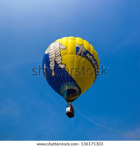 PUTRAJAYA, MALAYSIA - MARCH 30:The tethered hot air balloon rides for public at the 5th Putrajaya International Hot Air Balloon Fiesta in Putrajaya, Malaysia on March 30, 2013 - stock photo