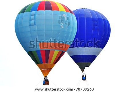 PUTRAJAYA, MALAYSIA-MARCH 23: Two hot air balloons alongside rides at the 3rd Putrajaya International Hot Air Balloon Fiesta Mar 23, 2011 in Putrajaya, Malaysia. More than 300,000 people visit this year event. - stock photo