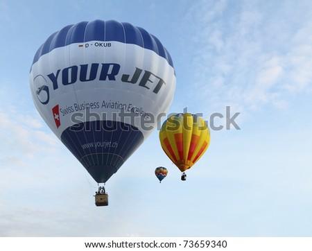"PUTRAJAYA, MALAYSIA - MARCH 19: ""Your Jet Balloon"" & other hot air balloons in flight during 3rd Putrajaya International Hot Air Balloon Fiesta 2011, held at Putrajaya, Malaysia on 19 March, 2011. - stock photo"