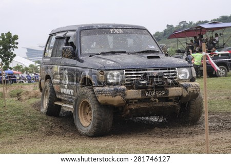 PUTRAJAYA, MALAYSIA - 24 MAY 2015. A 4x4 suv in action during Festival Belia Putrajaya 2015 . Festival Belia held at Putrajaya annually to attract youngster to get active and healthy life style.   - stock photo