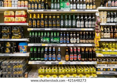 PUTRAJAYA, MALAYSIA - MAY 15, 2016: Rows of alcoholic drinks inside hypermarket in Putrajaya, Malaysia. - stock photo