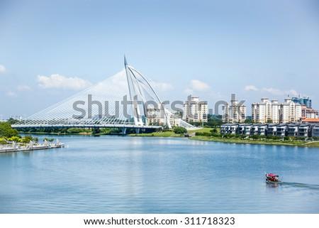 PUTRAJAYA, MALAYSIA - MAY 25: Seri Wawasan Bridge on May 25, 2014 in Putrajaya. It is a 370m long bridge which is built across the Putrajaya Lake in Putrajaya, Malaysia's federal administrative centre - stock photo