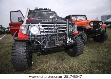 PUTRAJAYA, MALAYSIA - 24 MAY 2015. 4x4 jeep on auto show at Festival Belia Putrajaya 2015. The event held annually to attract youngsters with outdoor activity. - stock photo