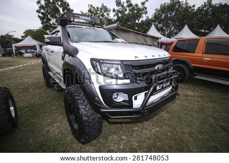 PUTRAJAYA, MALAYSIA - 24 MAY 2015. 4x4 truckon auto show at Festival Belia Putrajaya 2015. The event held annually to attract youngsters with outdoor activity. - stock photo