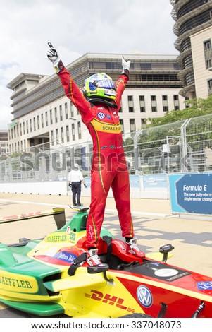 Putrajaya, Malaysia - November 7, 2015 : Brazillian Lucas de Grassi of Team ABT Schaeffler Audi celebrates after winning the FIA Formula-e ePrix Championship Putrajaya, Malaysia - stock photo