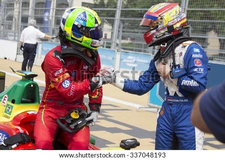 Putrajaya, Malaysia - November 7, 2015 : Brazillian Lucas de Grassi of Team ABT Schaeffler Audi celebrates with 3rd place Robin Frijns after winning the FIA Formula-e Championship Putrajaya, Malaysia - stock photo