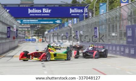 Putrajaya, Malaysia - November 7, 2015 : German Daniel Abt of Team ABT Schaeffler Audi enters turn 1 at FIA Formula-e ePrix Championship Putrajaya, Malaysia - stock photo