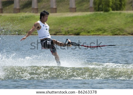 PUTRAJAYA, MALAYSIA - OCTOBER 9: Hagama Sunjiro from Japan showing his skills at 2011 IWWF Asian Waterski & Wakeboard Championships in Putrajaya, Malaysia on October 9, 2011. - stock photo
