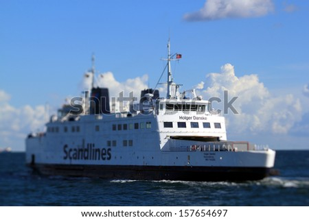 PUTTGARDEN, GERMANY - AUGUST 28: Scandlines ferry at Puttgarden harbour on August 28, 2012 in Puttgarden, Germany. Scandlines GmbH, established in 1998, is one of Europe's largest ferry companies. - stock photo