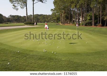 Putting green of golf course - stock photo