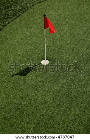 Putting Green with Flag - stock photo