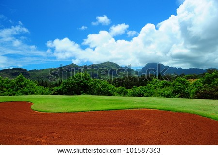 Putting in paradise on golf course in Kauai, Hawaii - stock photo