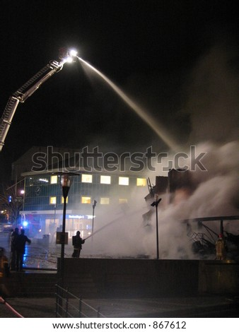 Putting out a burning building (some noise) - stock photo