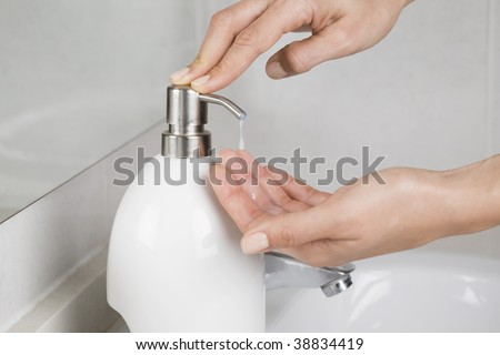 Putting soap on the hand - stock photo