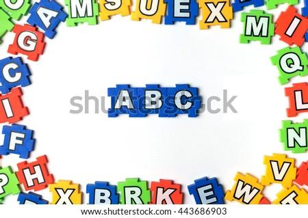 Puzzle ABC on white background - stock photo