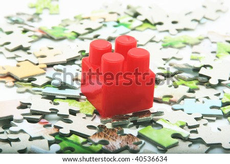 puzzle and one red lego - stock photo