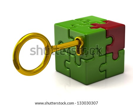 Puzzle cube with golden key - stock photo