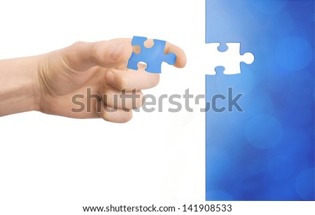 puzzle in hand - stock photo