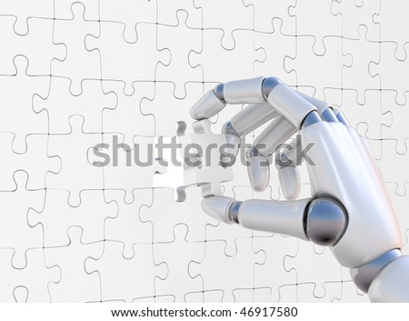 Puzzle in hand of robot on white background - stock photo