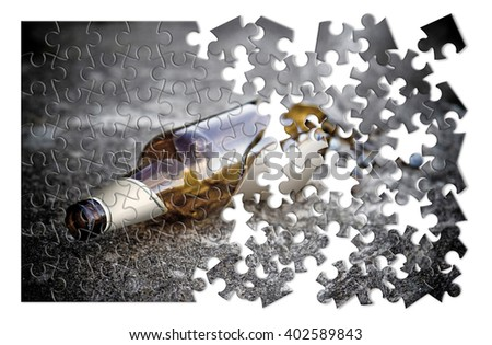 Puzzle of a broken bottle of beer resting on the ground - Free themselves from alcohol addiction - concept image - stock photo