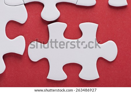 Puzzle over red background - stock photo