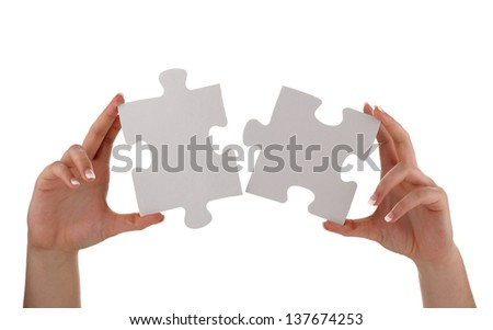 Puzzle pieces joining together concept for unity, teamwork or success with blank white face for message - stock photo