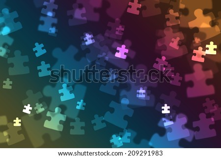 Puzzle pieces on a gradient background creating a bokeh effect - stock photo