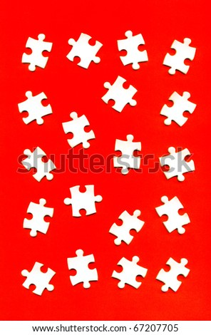 puzzle pieces on a red background - stock photo