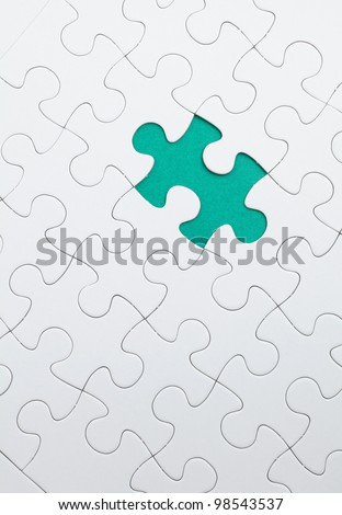 puzzle with green piece missed - stock photo