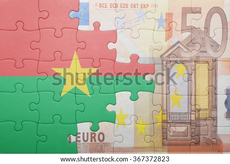 puzzle with the national flag of burkina faso and euro banknote . concept - stock photo