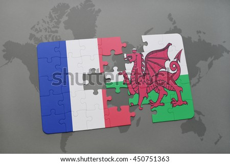 puzzle with the national flag of france and wales on a world map background. 3D illustration - stock photo