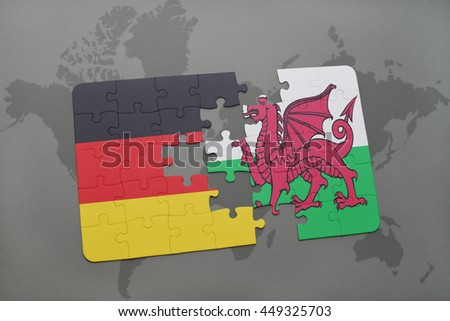 puzzle with the national flag of germany and wales on a world map background. 3D illustration - stock photo