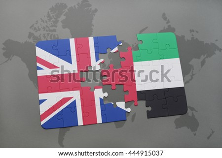 puzzle with the national flag of great britain and united arab emirates on a world map background. - stock photo