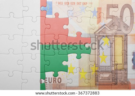 puzzle with the national flag of madagascar and euro banknote . concept - stock photo