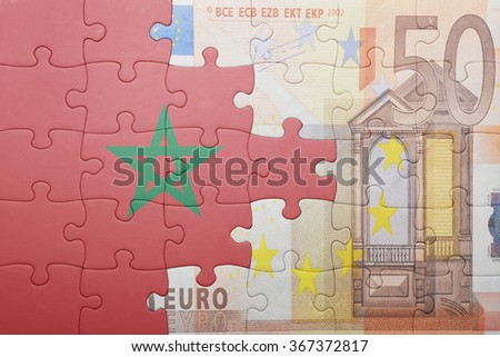 puzzle with the national flag of morocco and euro banknote . concept - stock photo