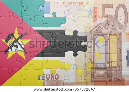 puzzle with the national flag of mozambique and euro banknote . concept - stock photo