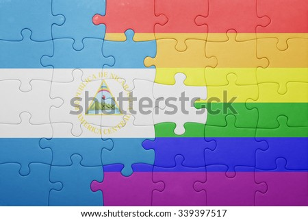 puzzle with the national flag of nicaragua and gay flag.concept - stock photo