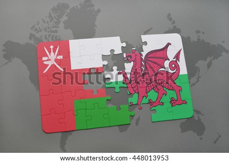 puzzle with the national flag of oman and wales on a world map background. 3D illustration - stock photo