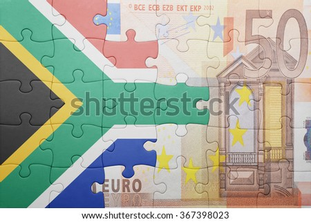 puzzle with the national flag of south africa and euro banknote . concept - stock photo
