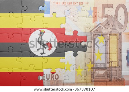 puzzle with the national flag of uganda and euro banknote . concept - stock photo