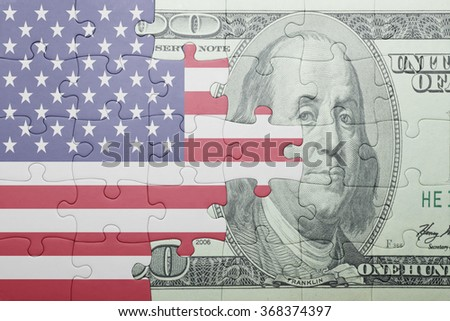 puzzle with the national flag of united states of america and dollar banknote . concept - stock photo