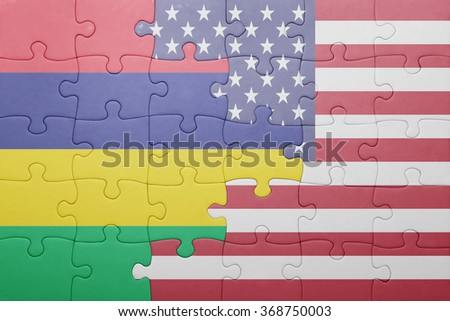 puzzle with the national flag of united states of america and mauritius .concept - stock photo
