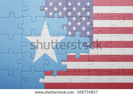 puzzle with the national flag of united states of america and somalia .concept - stock photo